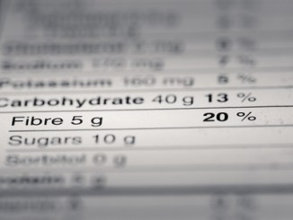47053860 - shallow depth of field image of nutrition facts fiber information we can find on a grocery store product.