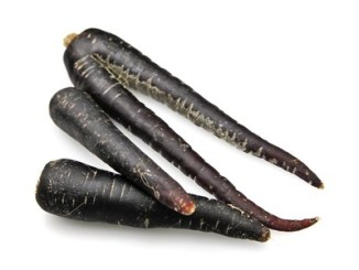Black carrots on white background