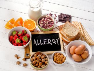 Food allergies. Allergic food on wooden background.