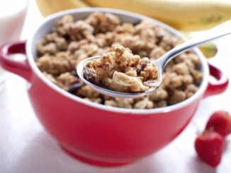 breakfast in a red bowl. Many breakfasts contain fibre as part of their main ingredients. ID-100227607