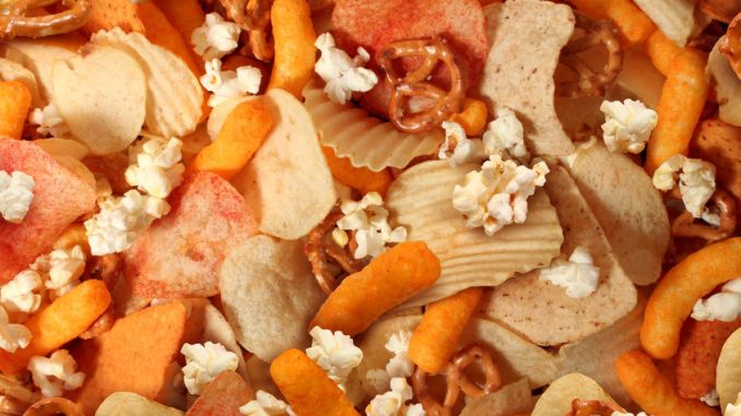 Extruded foods. Snacks of assorted shapes and sizes produced by extrusion.
