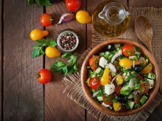 43877583 - greek salad with fresh vegetables, feta cheese and black olives