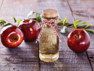 Apple cider vinegar and red apples