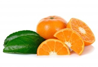 Carotenoids provide wonderful vibrant colour in these orange segments. There is a whole orange and green leaf on a white background.