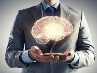 43779665 - close up of businessman holding digital image of brain in palm