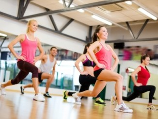 24117789 - fitness, sport, training, gym and lifestyle concept - group of smiling people exercising in the gym
