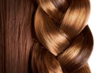 Braid hairstyle - brown long hair close up -healthy hair.