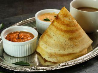 Cone shape masala dosa with sambar and chutney, south Indian breakfast