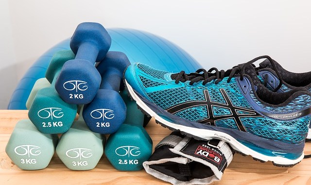 Training shoes, dumbbells, blue weights ball and all for exercising with to reduce muscle atrophy.