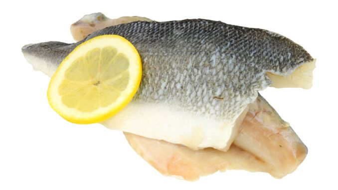 basa fillets with a slice of lemon on a white background