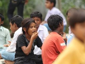Ras malai, indian cuisine, children eating authentic holi sweet dough balls