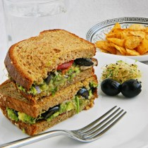 Guacamole and alfalfa sprouts sandwich