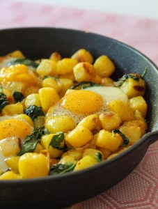 spinach, potatoes and eggs baked in a cast iron pan