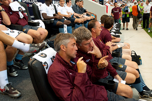 Manchester City manager Roberto Mancini outlines a prank on David Platt to his assistant Brian Kidd.
