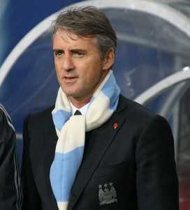 Manchester City manager Roberto Mancini has allowed Liverpool captain Steven Gerrard to borrow his lawnmower.