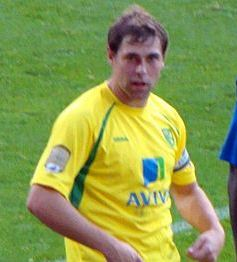 Grant Holt scored twice for Norwich City in the Canaries' 3-2 win over Swansea City at the Liberty Stadium.