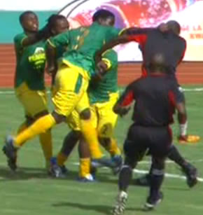 Young Africans player Stephano Mwasika punches a referee in the head