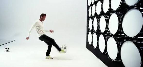 David Beckham shoots a ball at a set of drums during Samsung Galaxy Note ad