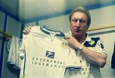 Leeds United manager Neil Warnock holds up the new 2012/13 Leeds kit during the promotional rap video