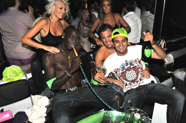 Mario Balotelli getting a massage in the VIP area of a club in Saint-Tropez