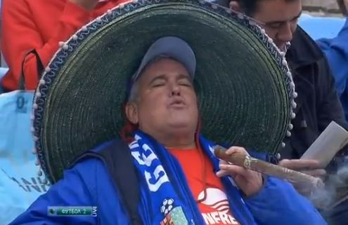 A Getafe fan smokes a huge cigar before the match against Levante