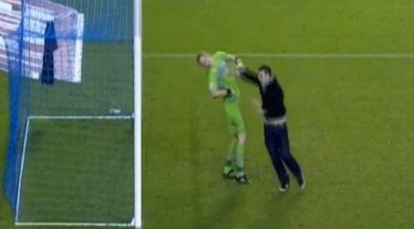 Sheffield Wednesday goalkeeper Chris Kirkland is attacked by Leeds United fan Aaron Cawley