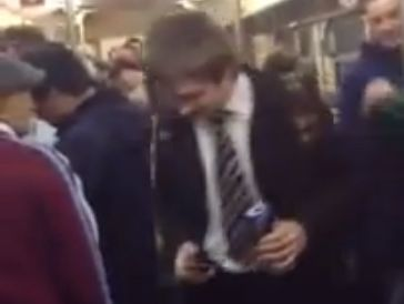 West Ham fans verbally abuse a suit-wearing schoolboy on the train