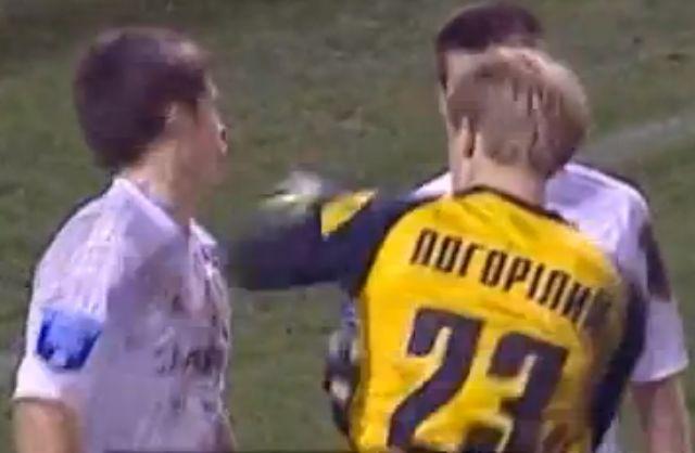 Tavriya goalkeeper Serhiy Pohorilyi punches Vorskla's Artem Gromov in the face