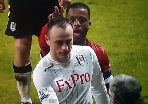 Patrice Evra mocks Dimitar Berbatov after United beat Fulham in the FA Cup