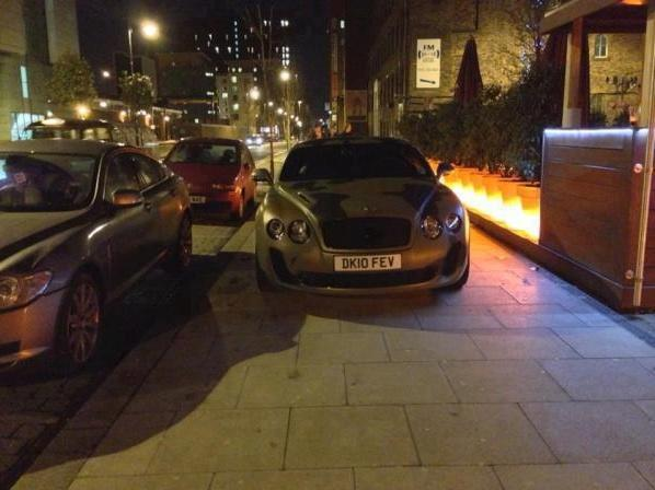 Mario Balotelli parks on the pavement outside an Indian restaurant in Manchester city centre
