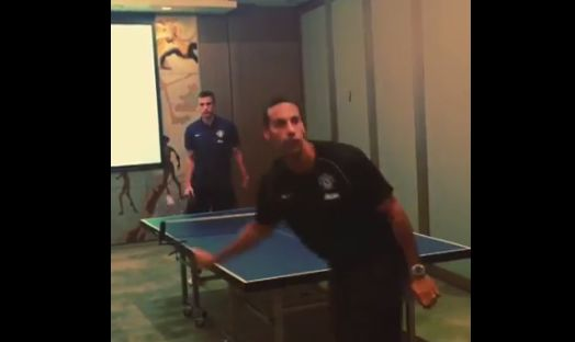 Ferdinand and van Persie play table tennis without looking while on Manchester United's pre-season tour in Sydney