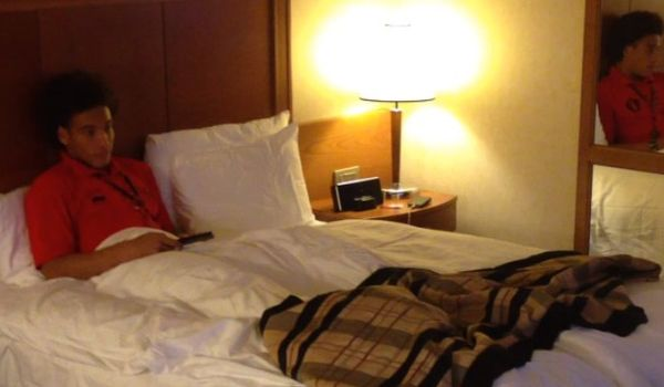 Axel Witsel starts of the many Belgium players in bed, watching a movie video