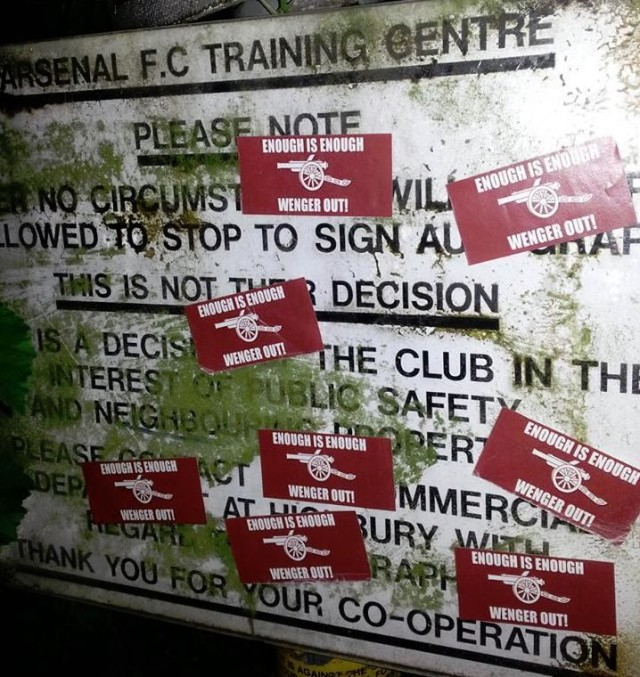 """Enough Is Enough - Wenger Out"" stickers on the Arsenal Training Centre sign, planted by angry Arsenal fans"