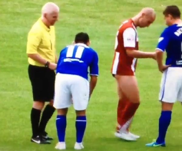 Gary Roberts pulls down shorts of Penn during Chesterfield v Cheltenham Town in League Two