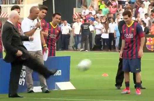 President of Israel Shimon Peres kicks a ball at Messi