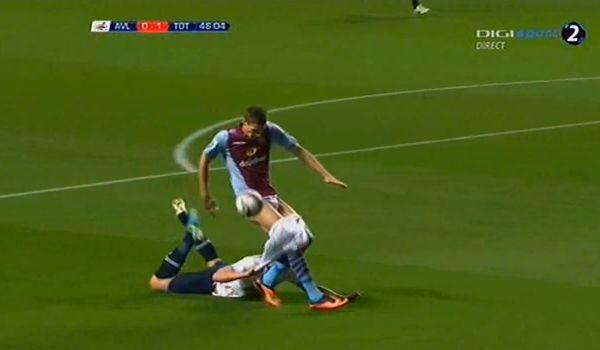 Jan Vertonghen pulls down Niklas Helenius's shorts during Spurs v Aston Villa in the Capital One Cup