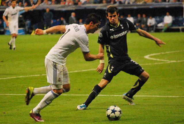 Cristiano Ronaldo takes on Gareth Bale