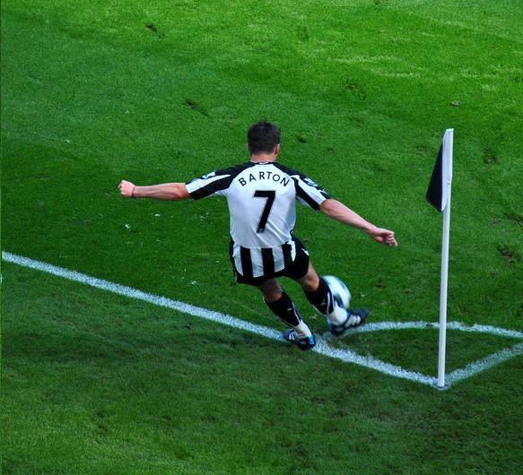 A Burnley fan has denied throwing a bottle at Joey Barton (pictured here taking a corner for Newcastle United)