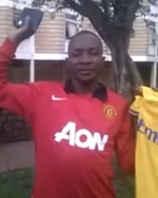 A Manchester United fan switches to Arsenal by changing shirts