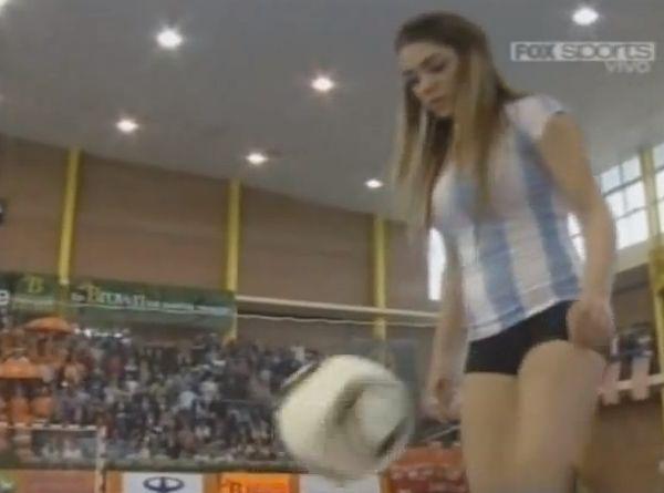 Argentinian model Fiorella Castillo does kick-ups in high heels at Copa America de Futsal 2011