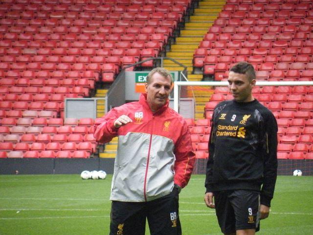 Brendan Rodgers and Iago Aspas of Liverpool
