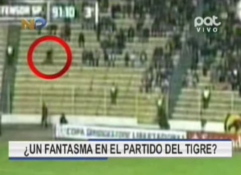 The Bolivian football ghost appears to run through the crowd during a match between The Strongest and Defensor Sporting