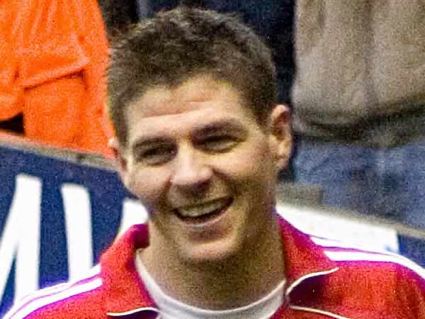 Steven Gerrard smiling, presumably before  he saw the #MoreThanGerrard tweets
