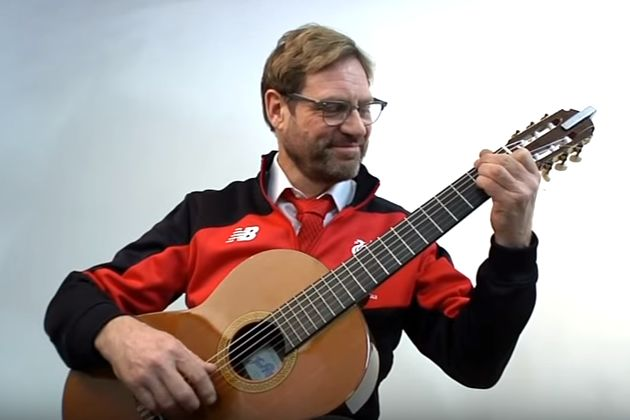 Jürgen Klopp lookalike plays You'll Never Walk Alone on the guitar