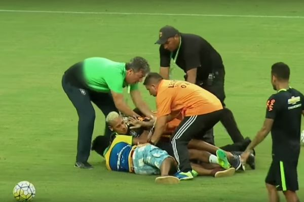 Brazil training pitch invaders bundle Neymar at an open session in Manaus