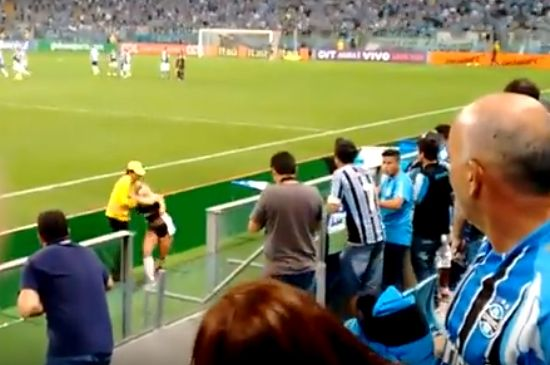 Miss Bumbum pitch invader gets onto the pitch during Grêmio vs Palmeiras