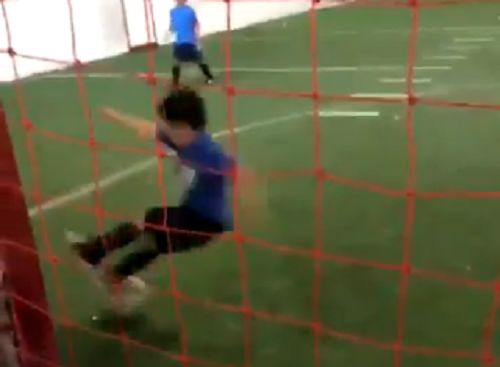 A small boy makes an accidental save in his first ever match