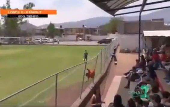 Lobos de Zacoalco's Ricardo Alves jumps into a fence for goal celebration in Mexican fourth tier clash