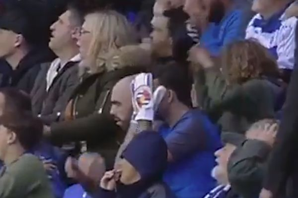 A Reading fan wearing goalie gloves in the crowd for game against Norwich