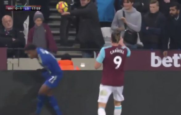A West Ham fan thows the ball at Demarai Gray as they host Leicester for a 1-1 draw